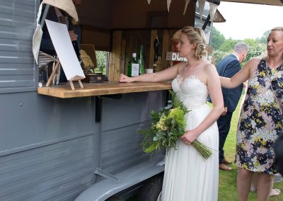 Bride & Groom enjoying the Fizz Box Bar at their Shropshire wedding